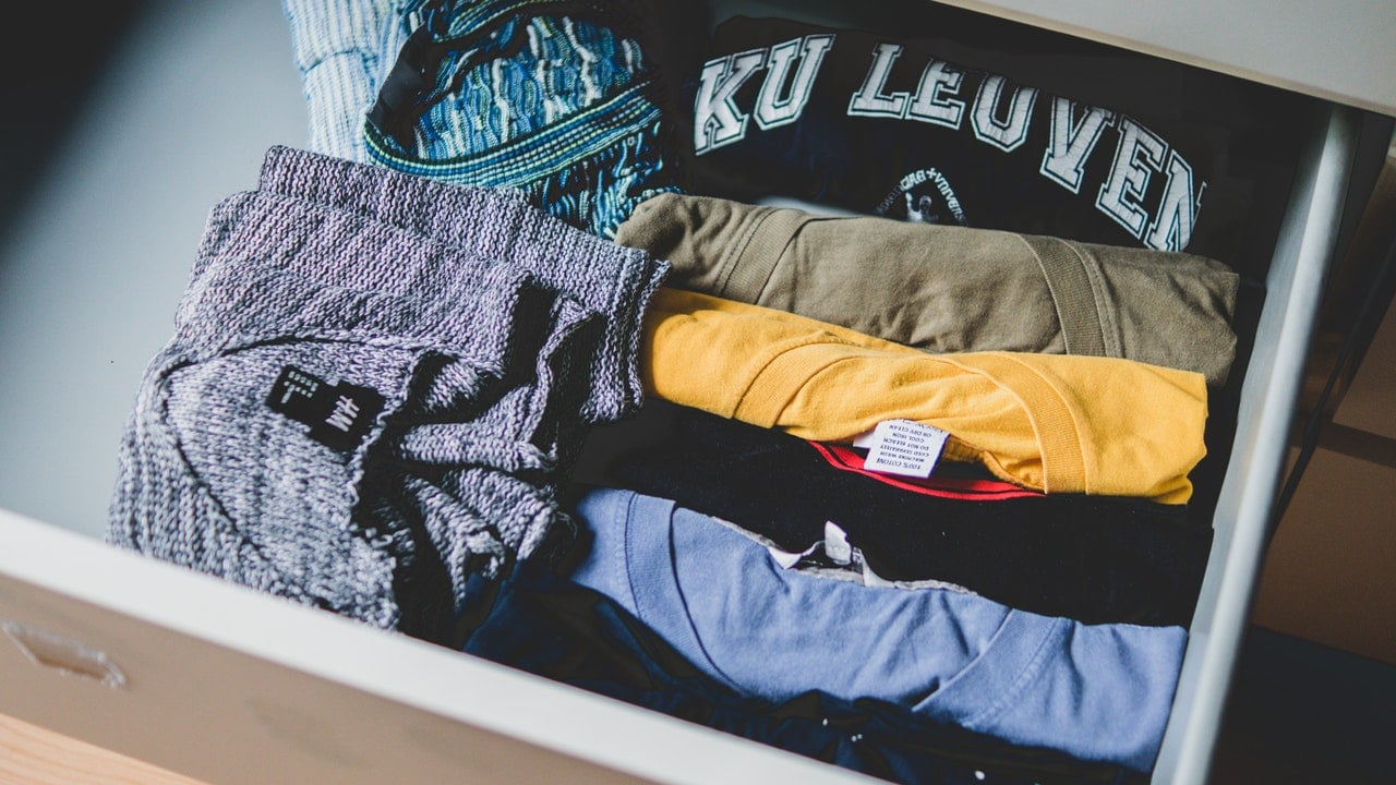 drawer full of different colored clothes